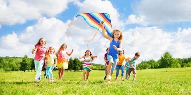 children running with kite