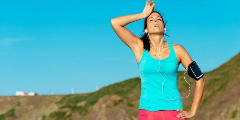 woman sweating after running
